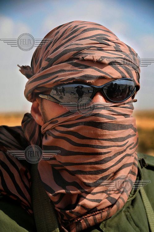 A portrait of a rebel fighter near the front line. Fighting between forces loyal to Muammar Gaddafi and anti-government forces continue across Libya. On 17 February 2011 Libya saw the beginnings of a revolution against the 41 year regime of Col Muammar Gaddafi.
