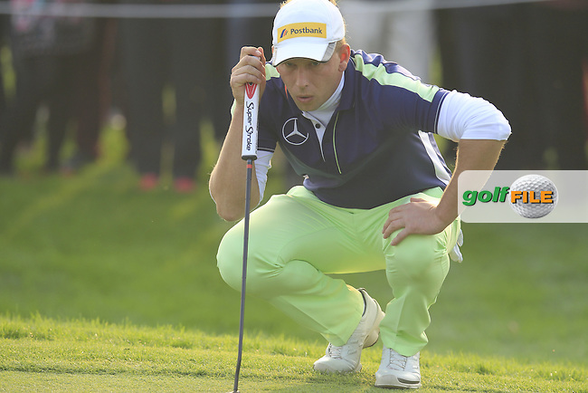 Marcel Siem (GER) lines up his putt at the 16th green from the crowd during Sunday's Final Round of the 2014 BMW Masters held at Lake Malaren, Shanghai, China. 2nd November 2014.<br /> Picture: Eoin Clarke www.golffile.ie