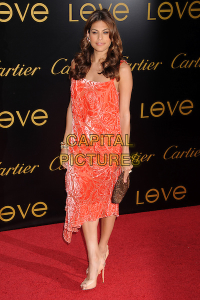 "EVA MENDES.Cartier's 3rd Annual ""Love Day"" Celebration at a Private Residence in Bel Air, Los Angeles, California, USA..June 18th, 2008.full length orange dress mendez velvet floral print gold bronze clutch bag.CAP/ADM/BP.©Byron Purvis/AdMedia/Capital Pictures."