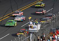 Apr 28, 2007; Talladega, AL, USA; A Nascar Busch Series flagman waves the yellow caution flag during the Aarons 312 at Talladega Superspeedway. Mandatory Credit: Mark J. Rebilas