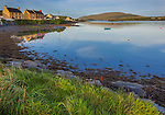 County Kerry, Ireland: Portmagee Channel with colorful houses of Portmagee and Bray Head in the distance