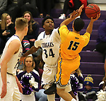 SIOUX FALLS, SD - DECEMBER 7: Troy Houghton #34 from the University of Sioux Falls picks up a foul while defending the shot against Isaiah McKay #15 from Concordia St. Paul during their game Friday night at the Stewart Center in Sioux Falls, SD. (Photo by Dave Eggen/Inertia)