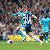 Tottenham Hotspur's Son Heung-Min (left) battles with Brighton & Hove Albion's Adam Webster (right) <br /> <br /> Photographer David Horton/CameraSport<br /> <br /> The Premier League - Brighton and Hove Albion v Tottenham Hotspur - Saturday 5th October 2019 - The Amex Stadium - Brighton<br /> <br /> World Copyright © 2019 CameraSport. All rights reserved. 43 Linden Ave. Countesthorpe. Leicester. England. LE8 5PG - Tel: +44 (0) 116 277 4147 - admin@camerasport.com - www.camerasport.com