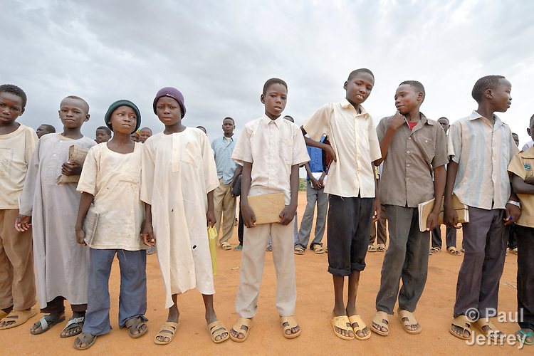 Boys line up before school in the Dereig Camp for internally displaced persons.