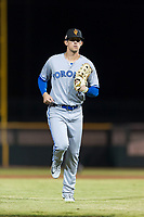 Surprise Saguaros right fielder Cavan Biggio (26), of the Toronto Blue Jays organization, jogs off the field between innings of an Arizona Fall League game against the Scottsdale Scorpions at Scottsdale Stadium on October 15, 2018 in Scottsdale, Arizona. Surprise defeated Scottsdale 2-0. (Zachary Lucy/Four Seam Images)