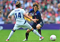 August 06, 2012..Japan's Mizuho Sakaguchi #6 and France's Louisa Necib #14 during Semi Final match at the Wembley Stadium on day ten in Wembley, England. Japan defeats France 2-1 to reach Women's Finals of the 2012 London Olympics.