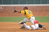 Richard Gonzalez #11 of the VCU Rams waits for the throw as Jimmy Parque #4 of the St. John's Red Storm steals second base at the Charlottesville Regional of the 2010 College World Series at Davenport Field on June 5, 2010, in Charlottesville, Virginia.  The Red Storm defeated the Rams 8-6.  Photo by Brian Westerholt / Four Seam Images
