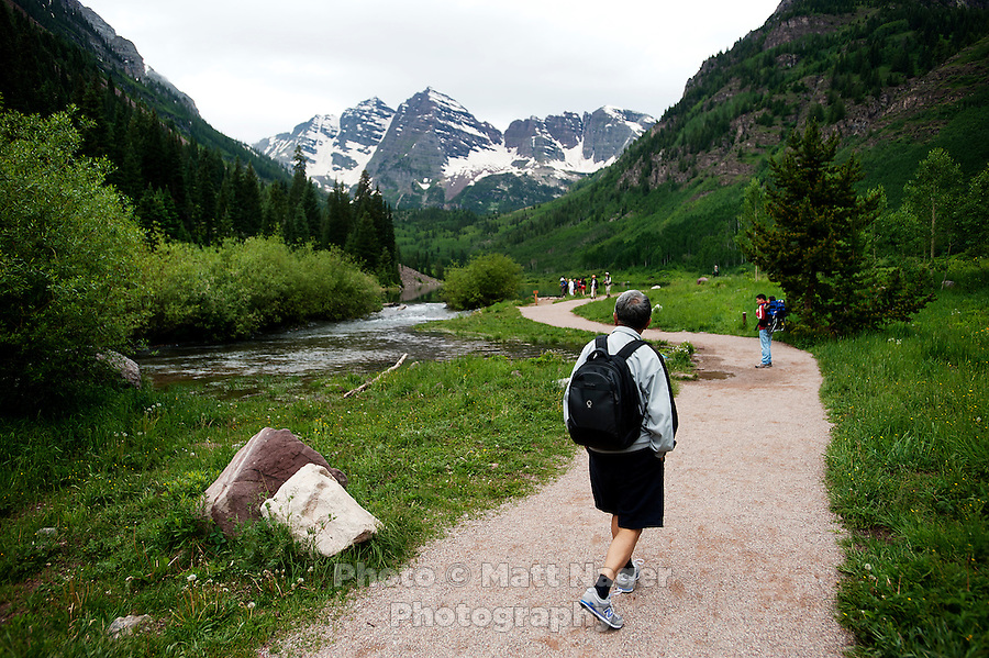 Hikers at the Maroon Bells from the Maroon Lake Scenic Trail in Aspen, Colorado, July 12, 2011...Photo by Matt Nager