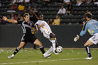 Los Angeles Galaxy forward (14) Edson Buddle attempts a shot as D. C. United defender (6) Greg Vanney and goalkeeper (1) Troy Perkins defend during a SuperLiga semifinal match at the Home Depot Center in Carson, CA on Wednesday, August 15, 2007..