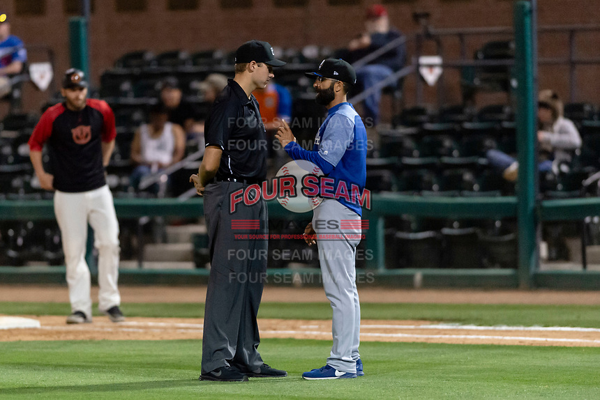Rancho Cucamonga Quakes manager Mark Kertenian argues with field umpire Trevor Dannegger during a California League game against the Visalia Rawhide on April 8, 2019 in Visalia, California. Rancho Cucamonga defeated Visalia 4-1. (Zachary Lucy/Four Seam Images)