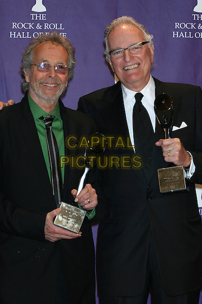 "HERB ALPERT & JERRY MOSS.21st Annual Rock and Roll Hall of Fame Induction Ceremony at the Waldorf Astoria in New York City, New York, USA..March 13th, 2006.Ref: IW.""Lifetime Achievement Award"" honorees and A&M Records founders half length award trophy glasses black.www.capitalpictures.com.sales@capitalpictures.com.©Capital Pictures"