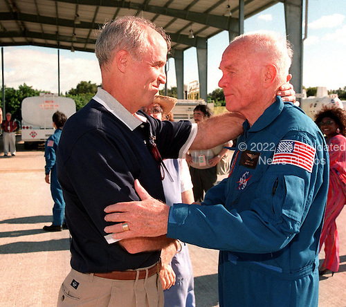STS-95 Payload Specialist John H. Glenn Jr. (right), senator from Ohio, embraces his son, David, after landing at Kennedy Space Center's Shuttle Landing Facility at Cape Canaveral, Florida aboard a T-38 jet on October 26, 1998. Barely visible behind them is Glenn's daughter, Lyn. Glenn and other crewmembers flew into KSC to make final preparations for launch. Targeted for liftoff at 2 p.m. on Oct. 29, the STS-95 mission includes research payloads such as the Spartan solar-observing deployable spacecraft, the Hubble Space Telescope Orbital Systems Test Platform, the International Extreme Ultraviolet Hitchhiker, as well as the SPACEHAB single module with experiments on space flight and the aging process. The mission is expected to last 8 days, 21 hours and 49 minutes, and return to KSC on Nov. 7, 1998. .Credit: NASA via CNP