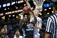 BROOKLYN, NY - Saturday December 19, 2015: Joel James (#42) of North Carolina goes up against Thomas Welsh (#40) of UCLA as the two square off in the CBS Classic at Barclays Center in Brooklyn, NY.