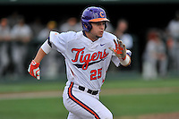 Catcher Chris Okey (25) of the Clemson University Tigers runs out a ball in a game against the Wofford College Terriers on Tuesday, March 1, 2016, at Doug Kingsmore Stadium in Clemson, South Carolina. Clemson won, 7-0. (Tom Priddy/Four Seam Images)