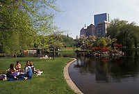 AJ3512, Boston, Boston Common, park, Massachusetts, People enjoying a warm spring day next to the pond in the Boston Common (oldest public park in America) in Boston in the state of Massachusetts.
