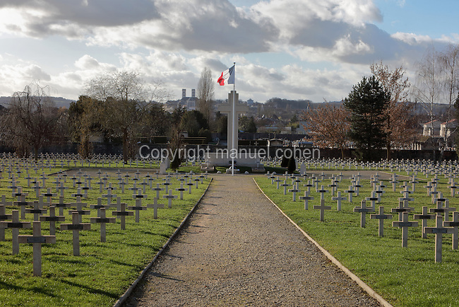 The Faubourg Pave Cemetery, or French National Cemetery, one of the 19 cemeteries from the Battle of Verdun in World War One, Verdun, Meuse, Lorraine, France. The cemetery contains 4906 war graves from World War One and 600 French war graves from World War Two. In the centre is the Cross of Sacrifice. This cemetery also houses the Carre des 7 Inconnus, or Square of the 7 Unknown, dedicated to unknown soldiers. Picture by Manuel Cohen