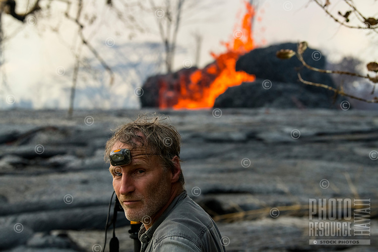 May 2018: A photographer with a headlamp strapped to his forehead near the Kilauea Volcano eruption in Leilani Estates, Puna, Big Island of Hawai'i.