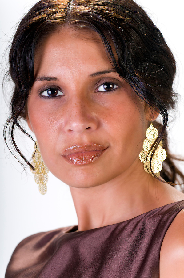 Portrait of latin woman in her thirties, looking at camera and smiling