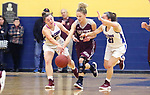 WATERBURY CT. 18 February 2018-021819SV06-#0 Sarah Wisniewski of Naugatuck High tries to bring the ball up court as #5 Emma Cretella and #21 Catherine Ciampi of St. Paul High defend during the NVL semi final at Kennedy High in Waterbury Monday.<br /> Steven Valenti Republican-American