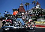 SAN DIEGO, CA - JULY 21:  Helmut Werb poses with a Harley Davidson Softtail in front of the Hotel Del Coronado during the Harley Davidson Release test ride for Stern Magazine on July 21 in San Diego, California. (Photo by Donald Miralle) *** Local Caption *** Helmut Werb