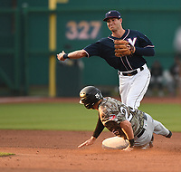NWA Democrat-Gazette/J.T. WAMPLER Naturals' Taylor Featherston catches Travelers' Nick Zammarelli at second base Monday June 3, 2019 at Arvest Ballpark in Springdale.
