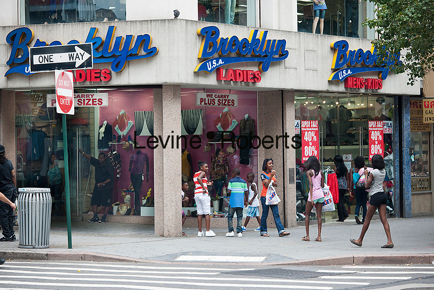 Stores and shopping in Downtown Brooklyn in New York on Saturday, August 25, 2012. The back to school shopping season is the second busiest time for retailers after Christmas.  (© Richard B. Levine)