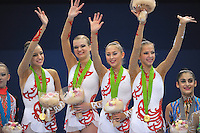 September 10, 2009; Mie, Japan;  (L-R) Evgeniya Kanaeva, Olga Kapranova, Daria Kondakova, Daria Dmitrieva of Russia celebrate winning team gold during awards ceremony at 2009 World Championships Mie. Photo by Tom Theobald.