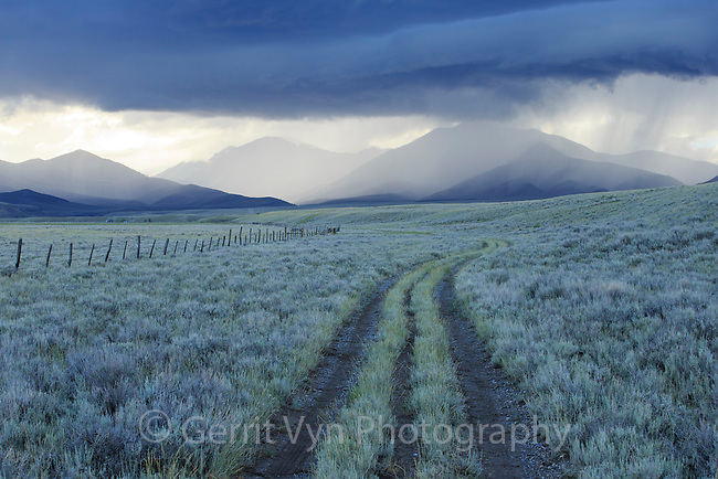 Rain showers over sagebrush-steppe at the foot of the Sawtooth Mountains. Clark County, Idaho.
