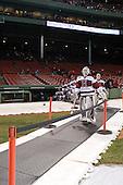 Steve Michalek (Harvard - 34) leads the Crimson to the ice. - The Union College Dutchmen defeated the Harvard University Crimson 2-0 on Friday, January 13, 2011, at Fenway Park in Boston, Massachusetts.