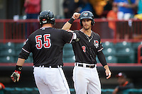 Erie SeaWolves right fielder Jeff McVaney (8) congratulates Dean Green (55) after a home run during a game against the Bowie Baysox on May 12, 2016 at Jerry Uht Park in Erie, Pennsylvania.  Bowie defeated Erie 6-5.  (Mike Janes/Four Seam Images)