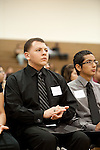 Aldine ISD Award winner Gregory Salinas applauds a fellow scholarship winner at the 2011 Aldine Scholarship Foundation Scholarship Ceremony at Lone Star College - North Harris.