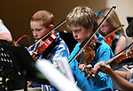 Spencer Bray, 13, left, and Jacob Bainton, 12, perform in the Carson City Symphony's Youth Strings Summer Program concert in Carson City, Nev., on Thursday, July 27, 2017. <br /> Photo by Cathleen Allison