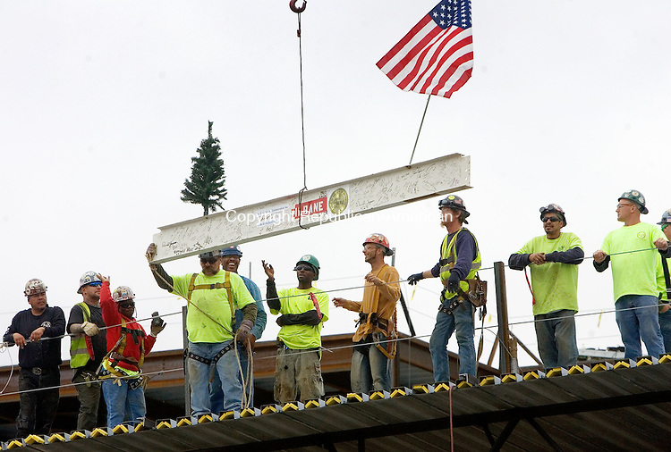 """WATERBURY, CT. 26 October 2012-102612SV04-Workers place one of the last steel beams into place at the new Waterbury Career Academy on Birch Street in Waterbury Friday. The Board of Education held a """"topping-out"""" ceremony for its new career academy. .Steven Valenti Republican-American"""