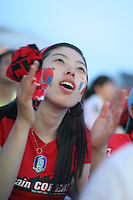 A South Korean National Soccer Team fan intently watches the FIFA World Cup first round match of Korea against France at the Fan Festival in downtown Leipzig, Germany after their team trailed 1-0. in the first half, June 18th, 2006. The teams drew 1-1.