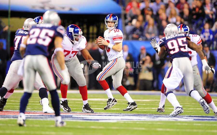 Feb 5, 2012; Indianapolis, IN, USA; New York Giants quarterback Eli Manning (10) drops back to pass during the first half of Super Bowl XLVI against the New England Patriots at Lucas Oil Stadium.  Mandatory Credit: Mark J. Rebilas-