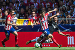 Franco Vazquez (r) of Sevilla FC fights for the ball with Sime Vrsaljko (c) and Gabriel Fernandez Arenas, Gabi, of Atletico de Madrid during the La Liga 2017-18 match between Atletico de Madrid and Sevilla FC at the Wanda Metropolitano on 23 September 2017 in Wanda Metropolitano, Madrid, Spain. Photo by Diego Gonzalez / Power Sport Images
