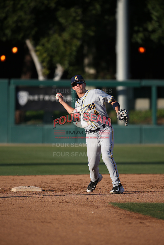 Ripken Reyes (4) of the California Bears makes a throw during infield practice before a game against the Southern California Trojans at Dedeaux Field on March 18, 2016 in Los Angeles, California. California defeated Southern California, 5-4. (Larry Goren/Four Seam Images)