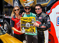 Jul 8, 2017; Joliet, IL, USA; NHRA top fuel driver Leah Pritchett with photographer Mark Rebilas and Papa Johns Pizza founder John Schnatter during qualifying for the Route 66 Nationals at Route 66 Raceway. Mandatory Credit: Mark J. Rebilas-USA TODAY Sports