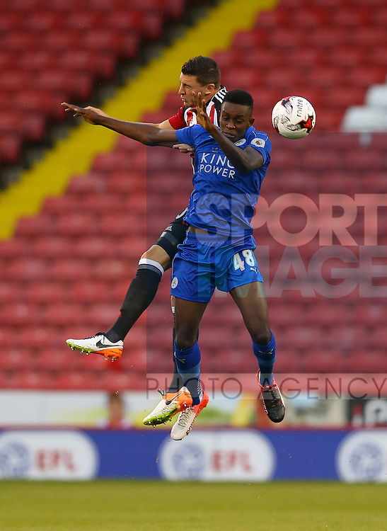James Wilson of Sheffield Utd tussles with Admiral Muskie of Leicester City U23 during the Checkatrade Trophy match at Bramall Lane Stadium, Sheffield. Picture date: August 30th, 2016. Pic Simon Bellis/Sportimage
