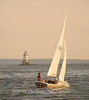 A boater makes his way towards the Conimicut light in Warwick.