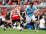 Doncaster Rover's Paul Green and Manchester City's Georgios Samaras