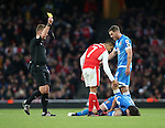 Arsenal's Alexis Sanchez gets booked for a foul on Bournemouth's Harry Arter during the Premier League match at the Emirates Stadium, London. Picture date October 26th, 2016 Pic David Klein/Sportimage