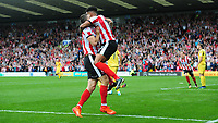 Lincoln City's Matt Green, right, celebrates scoring his sides equalising goal to make the score 1-1 with team-mate Sean Long<br /> <br /> Photographer Chris Vaughan/CameraSport<br /> <br /> The EFL Sky Bet League Two - Lincoln City v Morecambe - Saturday August 12th 2017 - Sincil Bank - Lincoln<br /> <br /> World Copyright &copy; 2017 CameraSport. All rights reserved. 43 Linden Ave. Countesthorpe. Leicester. England. LE8 5PG - Tel: +44 (0) 116 277 4147 - admin@camerasport.com - www.camerasport.com