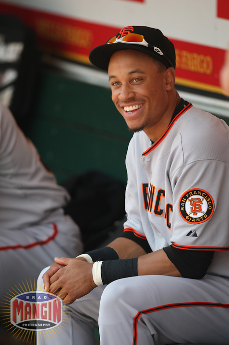 OAKLAND, CA - JUNE 29:  Emmanuel Burriss of the San Francisco Giants gets ready in the dugout before the game against the Oakland Athletics at the McAfee Coliseum in Oakland, California on June 29, 2008.  Photo by Brad Mangin