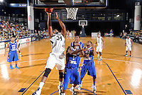 12 January 2012:  FIU's Joey De La Rosa (34) puts up a basket over MTSU's LaRon Dendy (1) and Marcos Knight (14) in the second half as the Middle Tennessee State University Blue Raiders defeated the FIU Golden Panthers, 70-59, at the U.S. Century Bank Arena in Miami, Florida.