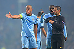 Vincent Company and Yaya Toure of Manchester City complain to the referee - Manchester City vs. CSKA Moscow - UEFA Champions League - Etihad Stadium - Manchester - 05/11/2014 Pic Philip Oldham/Sportimage
