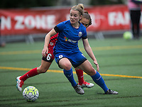 Seattle, WA - Saturday, May 14, 2016: Seattle Reign FC midfielder Kim Little (8) dribbles he ball in front of Portland Thorns FC midfielder Meleana Shim (6) during first half. The Portland Thorns FC and the Seattle Reign FC played to a 1-1 tie during a regular season National Women's Soccer League (NWSL) match at Memorial Stadium.