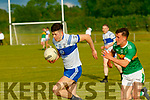 Adam Donoghue, Castleisland Desmonds races away from Mitchels Thomas Kerans, in the Div 2 County League game played at Camp, Ballyseedy, Tralee last Saturday evening.