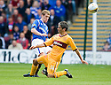 RANGERS' STEVEN DAVIS IS CHALLENGED BY MOTHERWELL'S KEITH LASLEY
