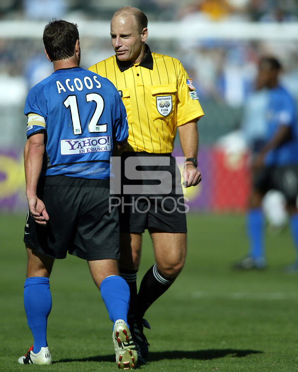 Referee Brian Hall has a word with team captain Jeff Agoos during MLS Cup 2003.  The San Jose Earthquakes defeated the Chicago Fire 4-2 in the MLS Championship at The Home Depot Center on November 23, 2003.
